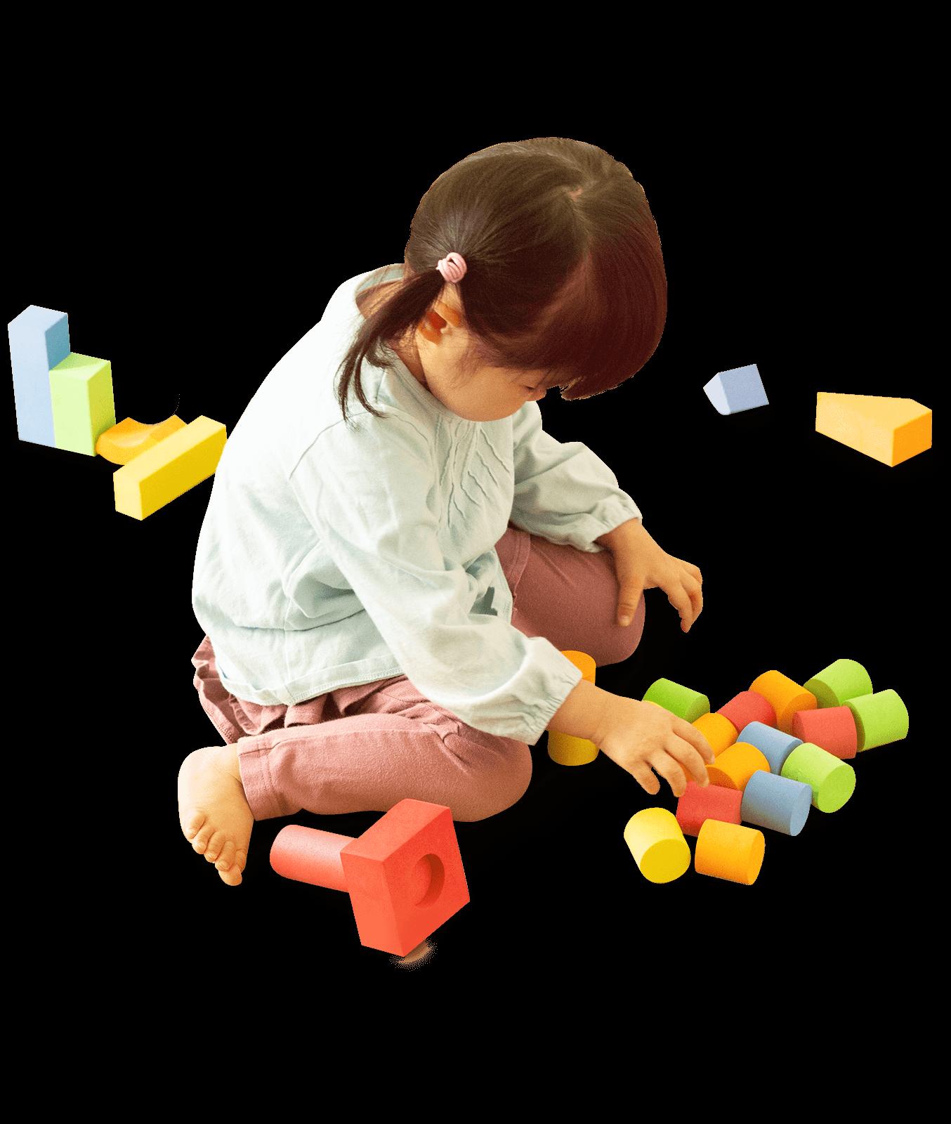 Bildungsräume Kind spielt mit Bauklötzen